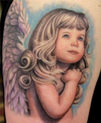 Amasing colorful blonde girl cherub tattoo