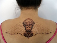 Lovely cherub with wings tattoo on back for women